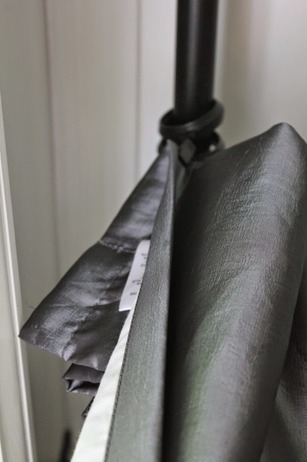 Using curtain clips, fold over longer curtains to keep from having to hem them to fit. A great way to reuse what you have.