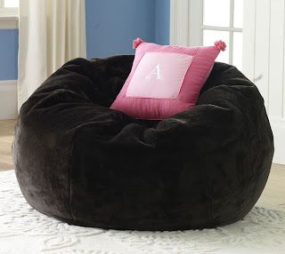 black upholstered ottomans