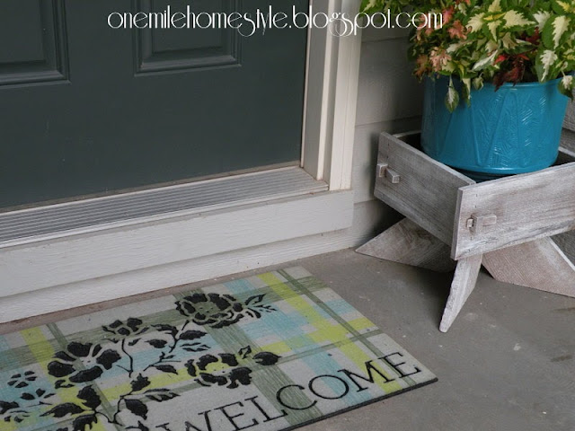 Painted planter box and flower pot with new welcome mat