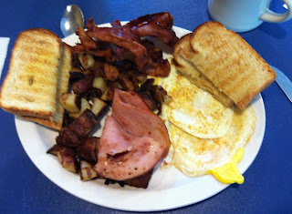 Photo of Simple Simon's 2 eggs (over hard), toast, ham, home fries, with an extra side of bacon by Don Taylor