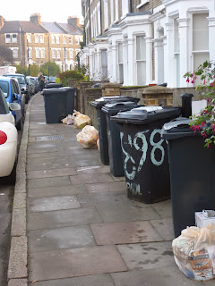 Photo of waste bins and recycling bags ready for collection on Paulet Road SE5 on vassallview.com