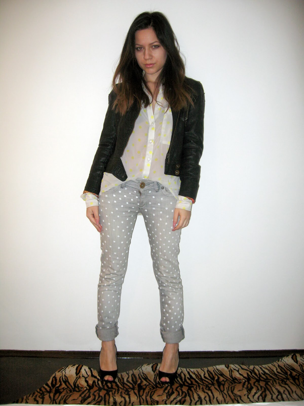 grey jeans with polka dots, sheer blouse with polka dots, black faux leather jacket, black pip toe heels