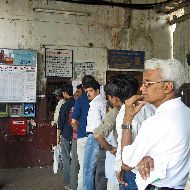 queue at ticket counter at mumbai railway station