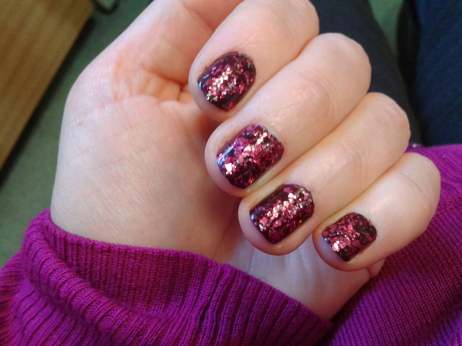 Dark burgandy and fuchsia glitter nail polish
