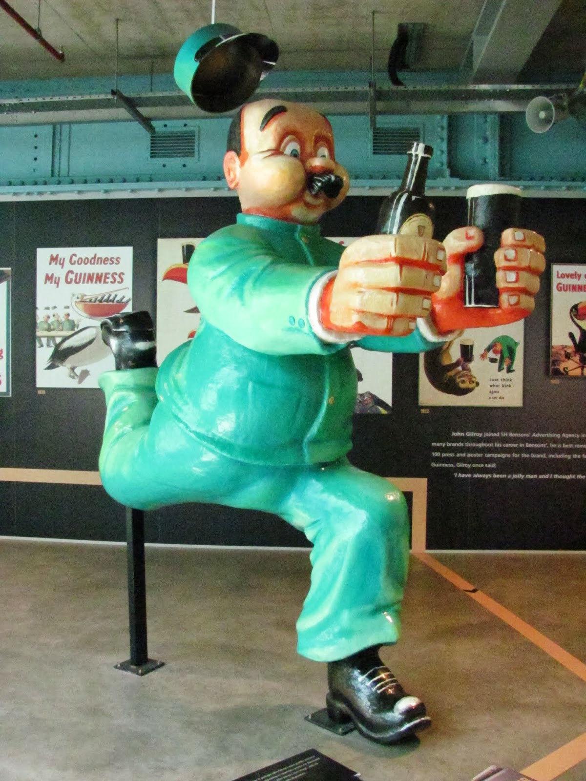 A sculpture of the Guinness advertising man running with beer at Guinness Storehouse, Dublin, Ireland