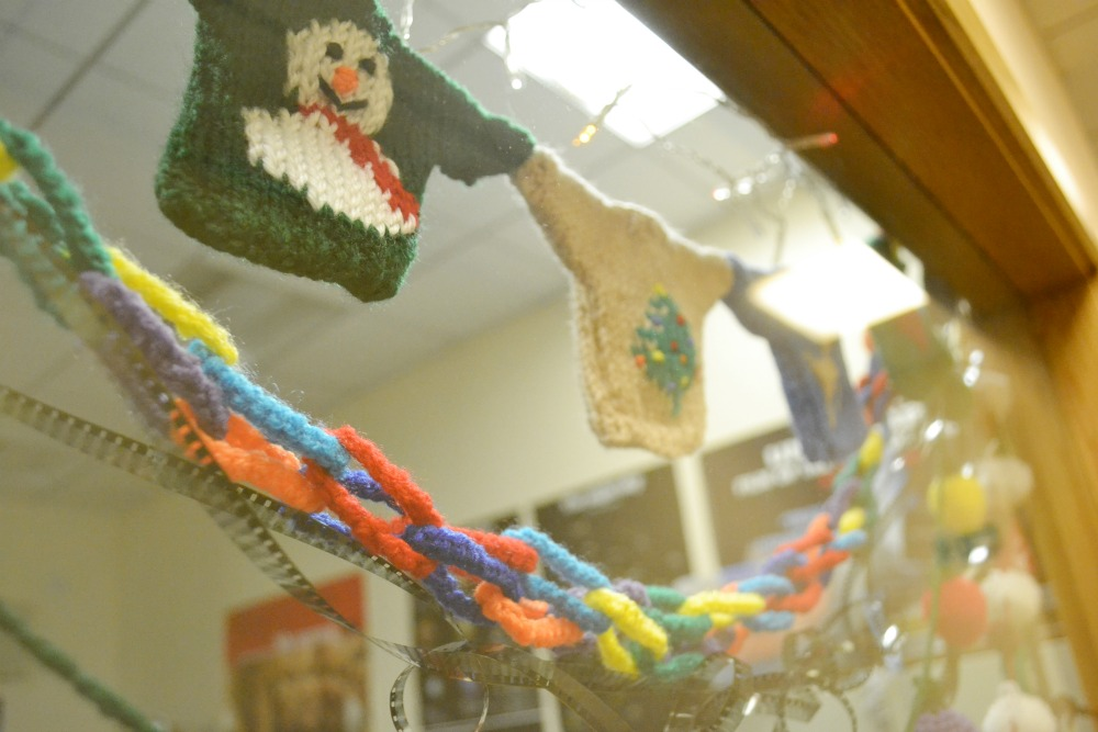 tiny knitted christmas jumpers sweaters window display