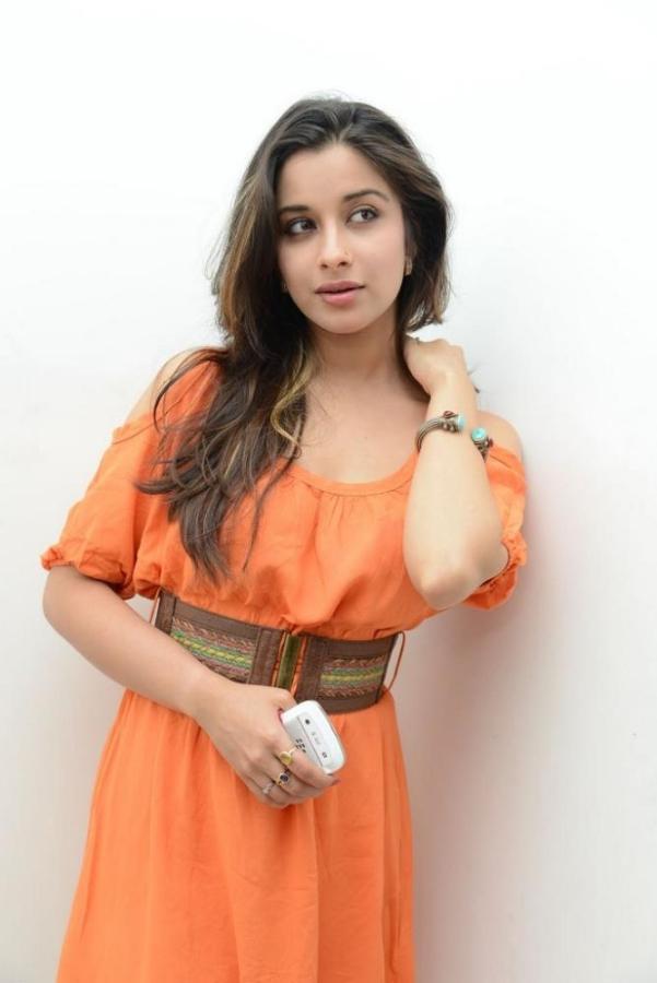stylish beloved sexy Madhurima latest hot stills in orange mini skirt