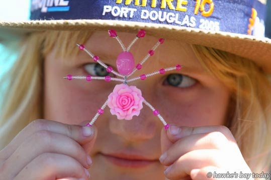 Zoe Rutherford, 8, Napier, with a BeadBug by Hastings artist Jill Norman, at the annual Haumoana Market Day, a fundraiser for Haumoana School, Haumoana. photograph