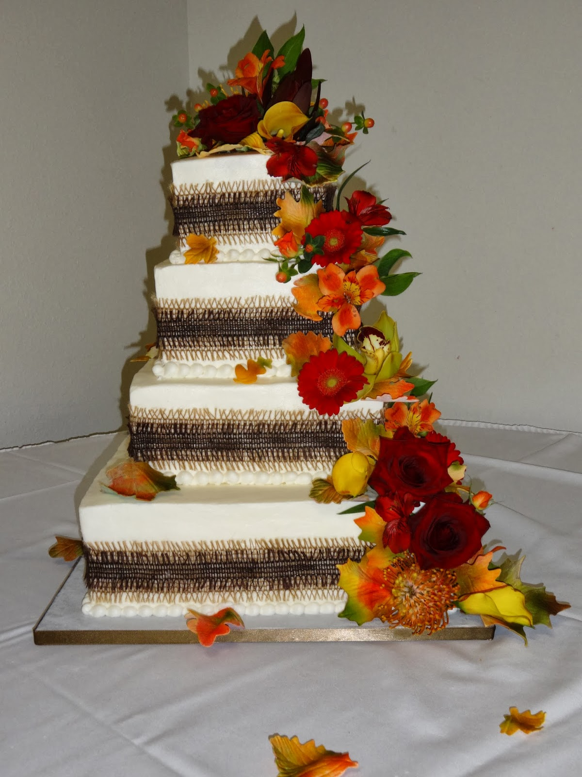 Cakes by Paula 4 tier Fall Wedding Cake and matching cupcakes
