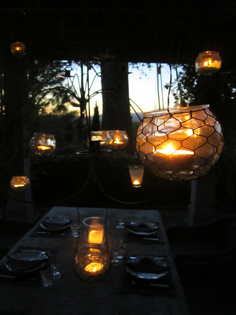 Candle lights hanging above a table