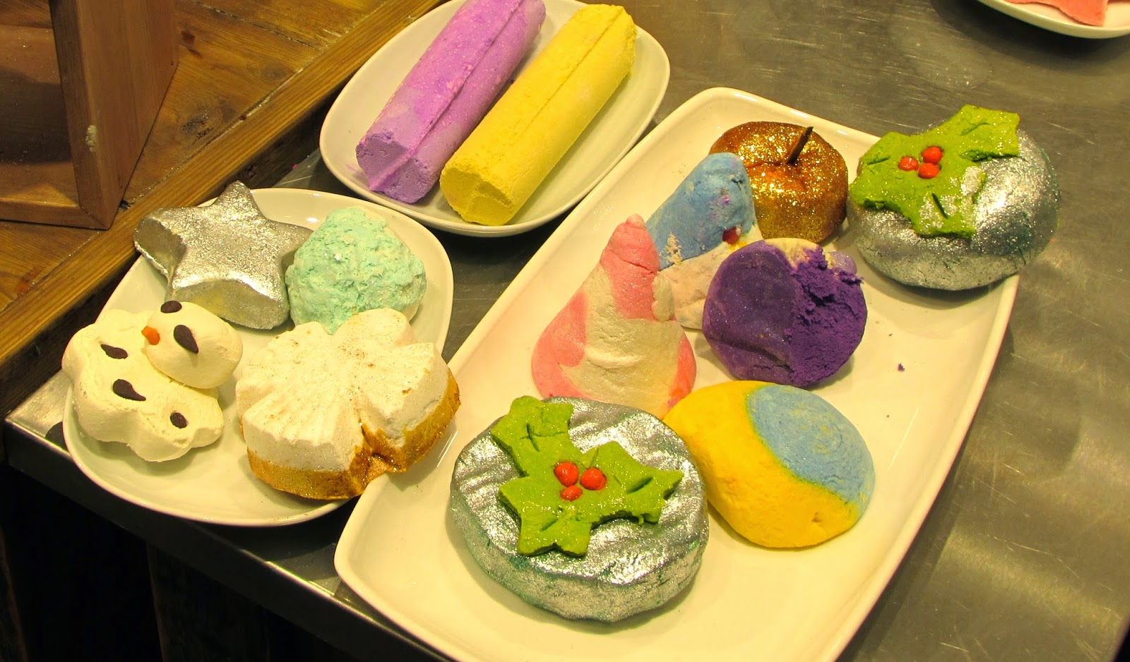 Lush Christmas bath bars on display: Holly Golightly, Christmas Eve, Candy Mountain etc