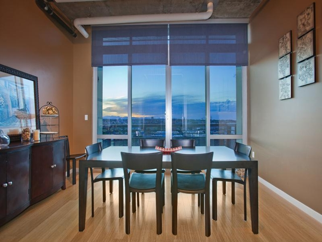 Small dinning room in Denver penthouse apartment with big windows and incredible views of the city