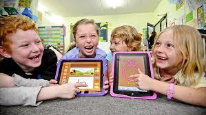 Children playing learning games on their iPads