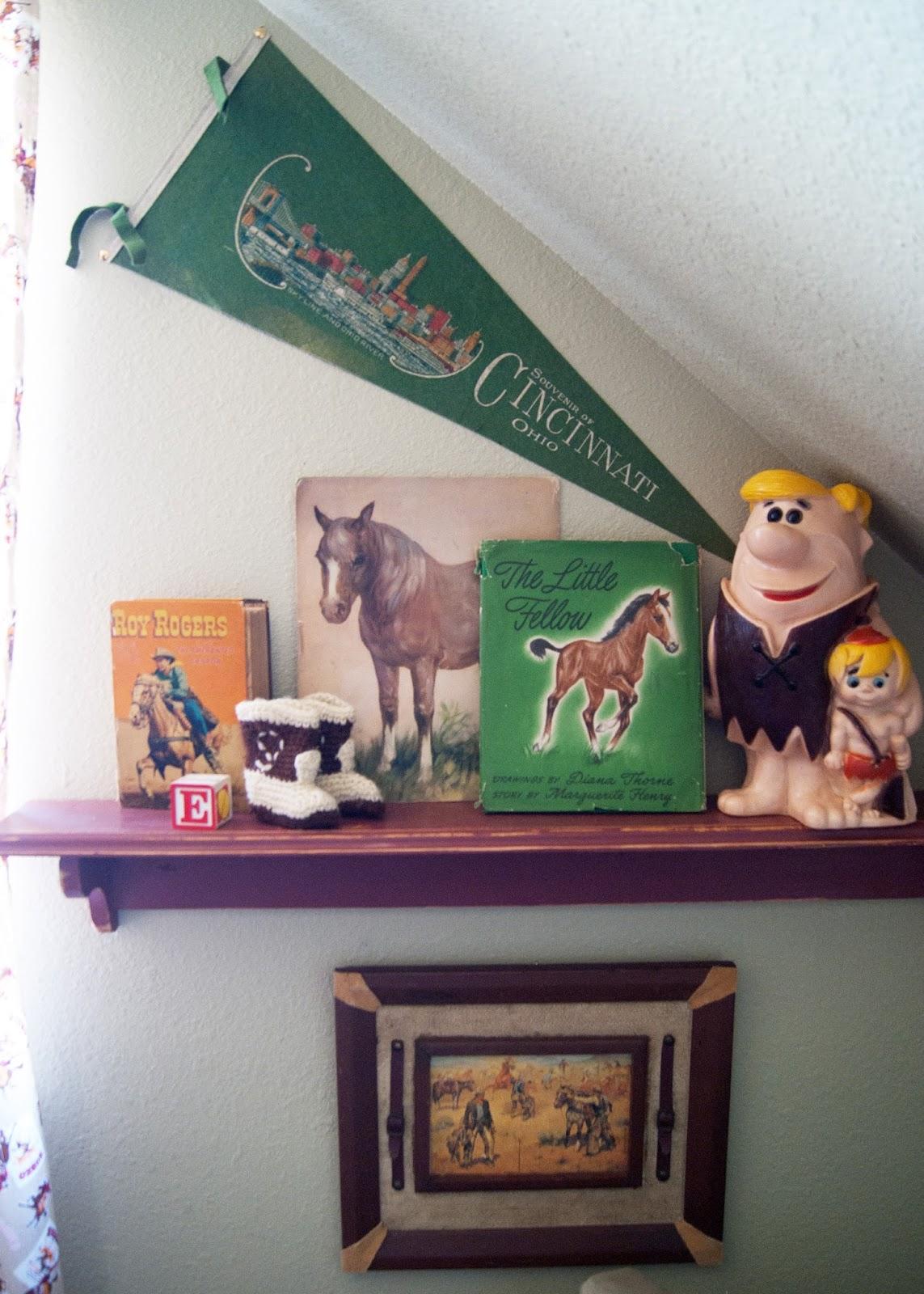 Vintage children books, crochet baby boots, letter E block, Penant and Barney Rubble piggy bank