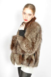 Vintage 1940's fluffy brown cropped length fox fur coat with front pockets.