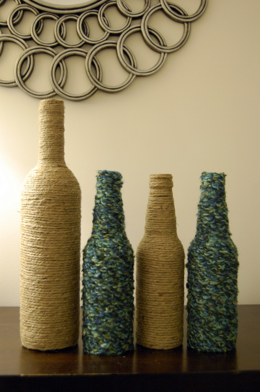 Pieces of anna diy wine and beer bottle vases for Wine bottle vase ideas