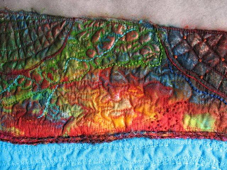detail multicolored quilt with applique, couching, embroidery