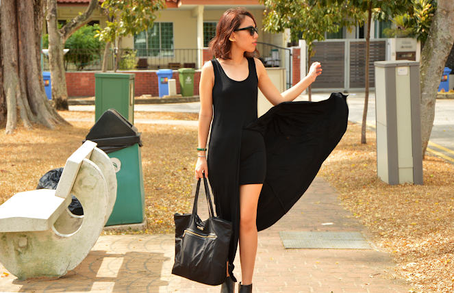 black maxi dress, cat eye sunglasses, black ankle boots, black tote bag