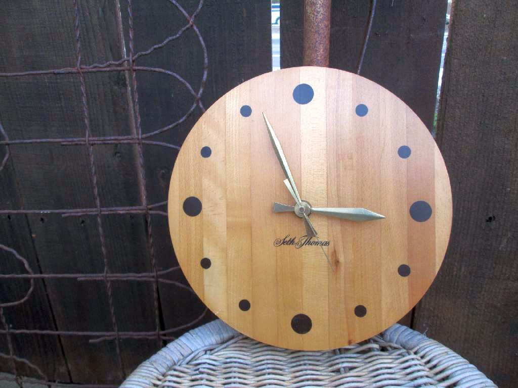 vintage wall clock made of blonde butcher block wood, for minimalist wall decor.
