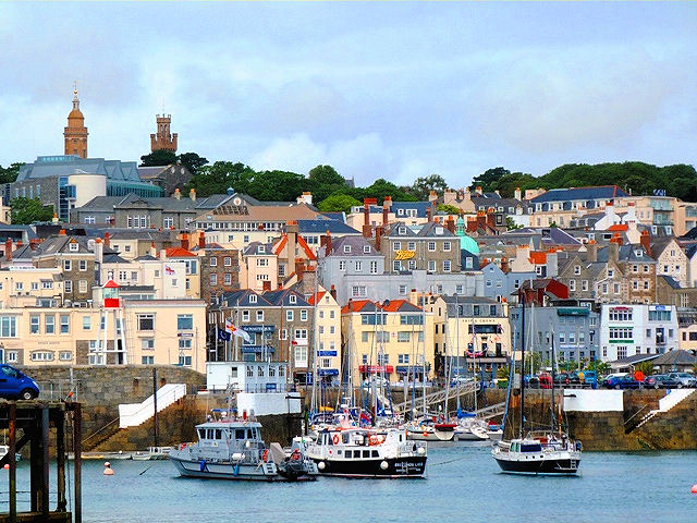 The picturesque seaside village of St. Peter Port in Guernsey, Channel Islands. Photo: Zoë Dawes. Unauthorized use is prohibited.
