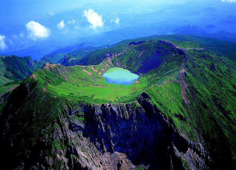 Jeju Island South Korea  city photos gallery : Sanbang Mountain on Jeju Island. The island is covered with yellow ...