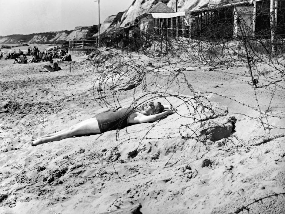 A woman sunbathes on bournemouth beach her august bank