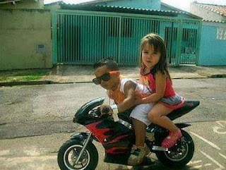 funny picture: children on a mini motorcycle