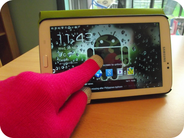 Swiping a tablet with the gloves