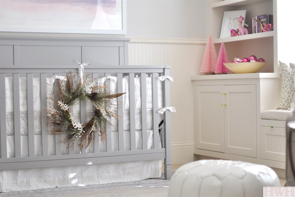 Pretty holiday wreath hung from crib in nursery.  | Honey We're Home
