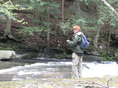 hiker by waterfall