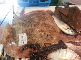 Image of fresh seafood for sale at a market in La Rochelle