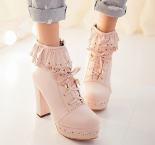 http://fashionkawaii.storenvy.com/products/12467379-japanese-sweet-lolita-falbala-high-heeled-boots