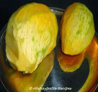peeled semi ripe mango