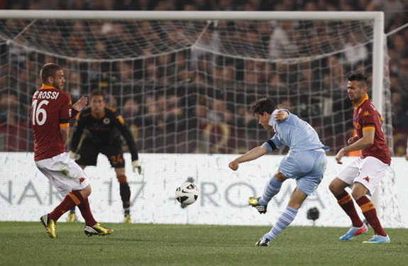 Lazio player Hernanes shoots from long range to score a goal against AS Roma