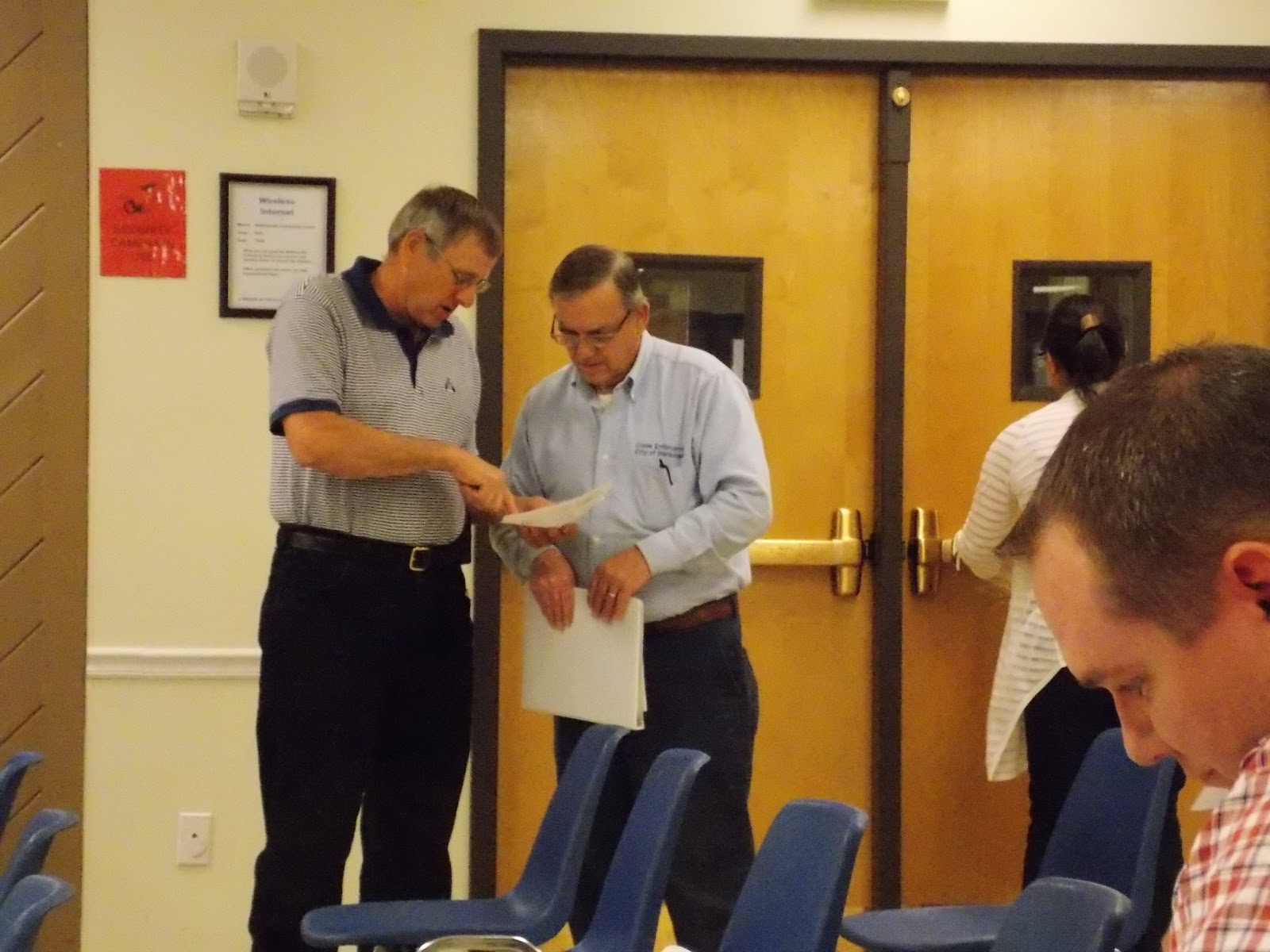 mike link and robert hegge discuss options during an extended zoning chat during the meeting wednesday