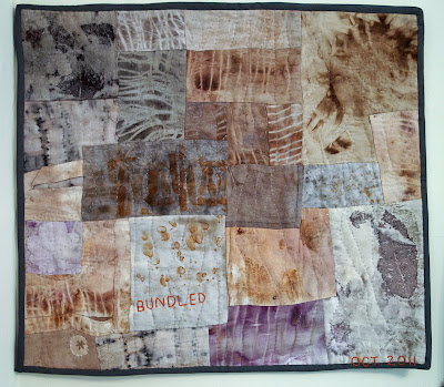wall hanging made from bundled natural dyes