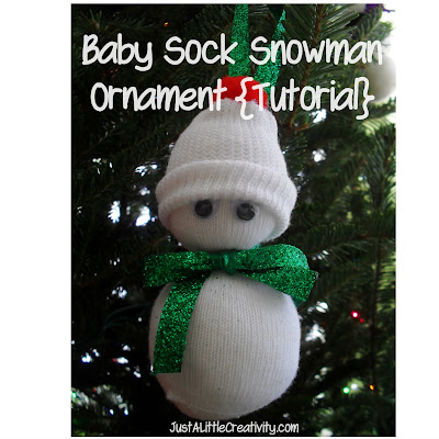 http://www.justalittlecreativity.com/2011/12/baby-sock-snowman-ornament-diy.html