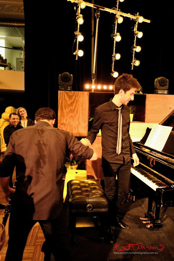 Shaking hands, It's done!  In performance, Andreas Ottensamer clarinete accomanied by pianist Alex Rainer plays 'Yellow Lounge' Street Fashion Sydney