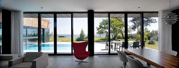 Red chair in Contemporary house in Ukraine by Drozdov & Partners