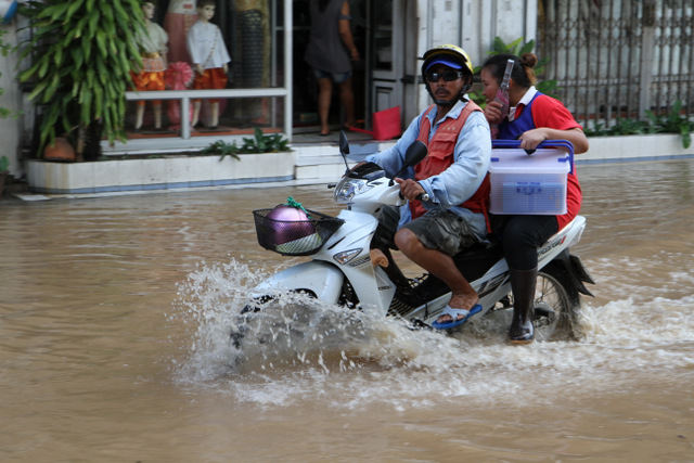 Motorbike taxi on flooded road in Phuket Town, 22nd August 2012