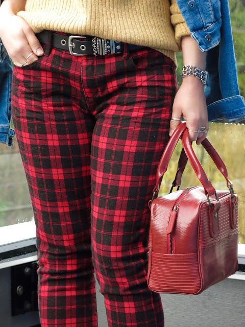 red plaid skinnies, camel turtleneck, denim jacket, and Elvis & Kresse bag