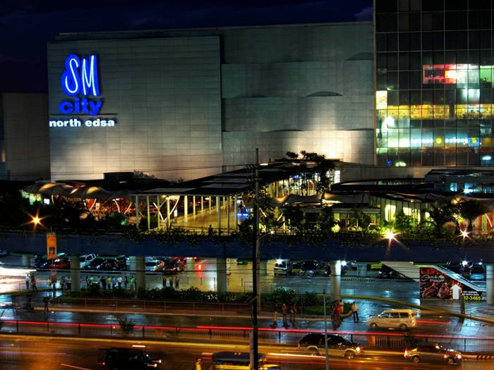 SM City North EDSA is a shopping mall located at the intersection of North Avenue and Epifanio de los Santos Avenue (EDSA) in Quezon City, Philippines. It is the largest shopping mall in Southeast Asia and third largest in the world in terms of leasable area (496,878 square meters). The mall is operated by SM Prime Holdings, a local company in the Philippines, and the biggest retail and mall operator in Southeast Asia. SM City North EDSA opened on November 25, 1985 with an original concept offered a variety of tenants and flagship stores. The mall's redevelopment began with the opening of The Block in July 2006, went into high gear with the launching of newly modernized Annex in December 2008, and the opening of the Sky garden in May 2009. The Car Park Plaza transformed into a lifestyle center on 2009. SM City North EDSA, a work in progress with the renovation of the City Center, and the development of the North Link. SM City North EDSA constructed at a challenging period in the Philippines' political history with a gross floor area of 120,000 square meters in 1985.