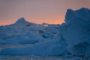 Sun setting behind the icebergs