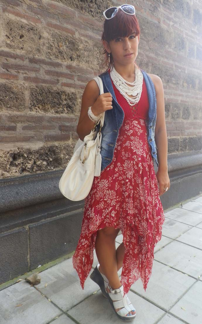 Outfit I am wearing: Red backless summer dress designed and handmade by my mom, Esprit denim vest, white vintage jewelry, white leather wedges from a local store, white purse and sunglasses from local stores