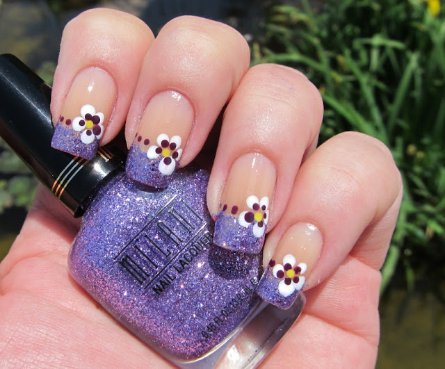 Purple nail art with pansies