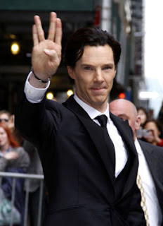 Benedict Cumberbatch doing Vulcan greeting to camera 