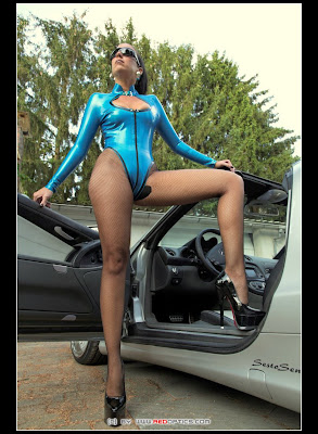 Smoking hot mistress in blue latex and fishnets