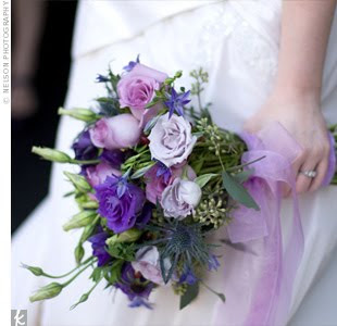 A lush purple wedding bouquet.