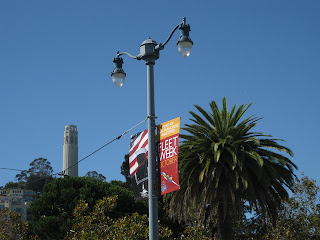 Coit Tower, Fleet Week banner, and a palm tree, San Francisco, California