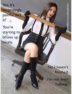 Domme with a heavy wooden paddle